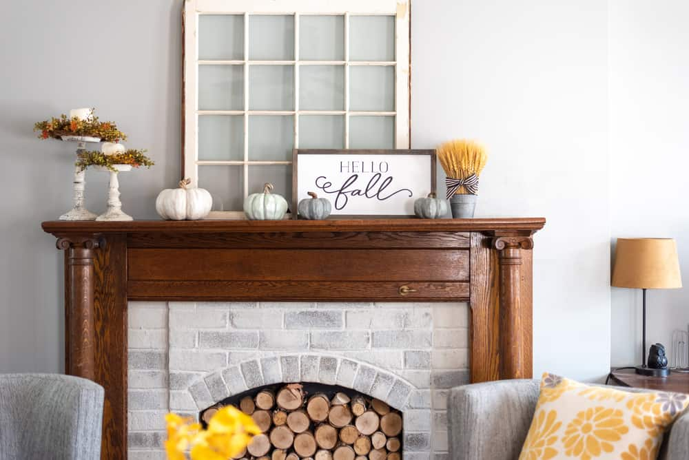 featured image showing a stylish fall decorated mantel